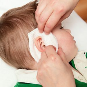 how to apply a compress in otitis